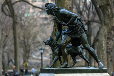 adams: NEW YORK - MARCH 12 2016: The Indian Hunter sculpture, dedicated in 1869 was the first sculpture in Central Park created by an American artist, John Quincy Adams Ward