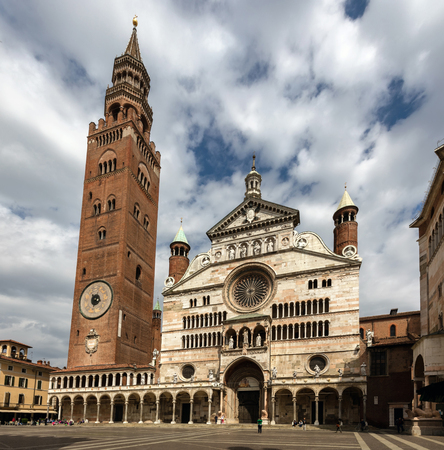 notable: CREMONA, ITALY - APRIL 26 2016: Cathedral of Cremona with the Torrazzo brickwork bell tower constitutes one of the most notable sites for Romanesque-Gothic art in northern Italy