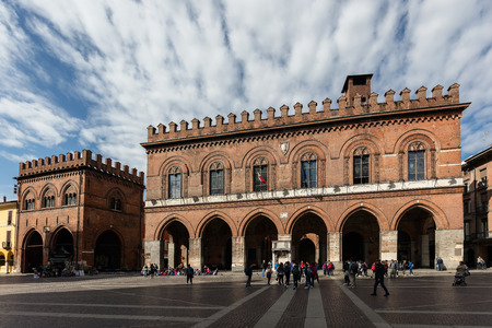 extensively: CREMONA, ITALY - APRIL 26 2016: Town Hall is the former seat of the Ghibelline power in the city. Rebuilt in the Romanesque-Gothic style between 1206 and 1246, it was later extensively remodeled.