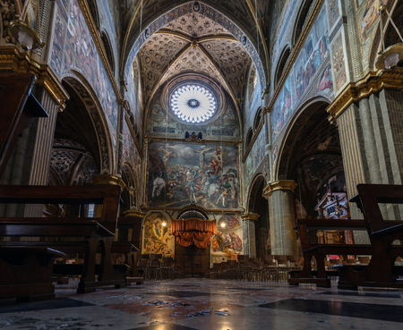 frescoed: CREMONA, ITALY - APRIL 26 2016: View of the nave and the inner facade of the Cremonas Cathedral. The Golgotha frescoed by Pordenone in 1521 dominates the nave.