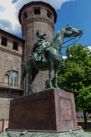 TURIN, ITALY - APRIL 24 2016: Equestrian monument portraying a military Carabinieri Cavalry with the reins in one hand and a banner, sculpted by Pietro Canonica in 1923 Editorial