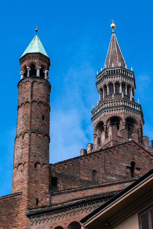 Torrazzo, the bell tower of the Cremonas Cathedral, completed in 1309, is the third tallest brick bell tower in the world and is the oldest brick structure taller than 100 m that is still standing. Stock Photo