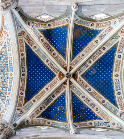 combines: Ceiling of the Certosa di Pavia. The monastery is typical of the Lombard architecture and combines Gothic and Renaissance styles. It was built by Carthusians in 1396-1495. Editorial