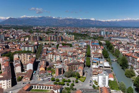 TURIN, ITALY - APRIL 25 2016: Panorama of the Turin, Italy with the snow covered Alps in the background, viewed from the Turin Eye air balloon.