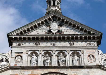the prophets: 12th century portal of Cremona Cathedral contains the figures of the Four Major Prophets, each bearing a roll with the text of their prophecies. Stock Photo