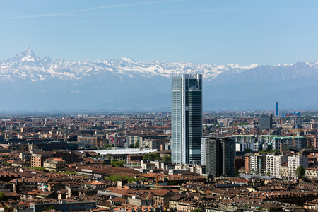 sprawl: TURIN, ITALY - APRIL 25 2016: Torre Intesa Sanpaolo in Turin, Italy is a skyscraper as well as the headquarters for the banking group Intesa Sanpaolo. The building is the second tallest in the city. Editorial