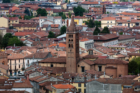 santagata: CREMONA, ITALY - APRIL 26 2016: 12th century bell tower of the Church of SantAgata, one of the oldest churches in the city of Cremona, Italy.