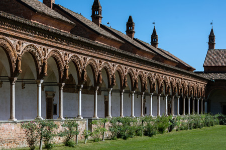 the prophets: Grand Cloister of the Certosa di Pavia monastery, built in 1396-1495, features columns with precious decorations in terracotta portraying saints, prophets and angels, in white and pink Verona marble. Stock Photo