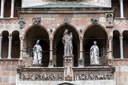 madonna: 14th century statues on the upper loggia of Cremona Cathedral are portraying the Madonna with Child and two bishops