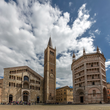 portals: PARMA, ITALY - APRIL 27 2016: Parma Cathedral built in Italian Romanesque style, consecrated by the Pope Paschal II in 1106. Its facade features three loggia floors and three portals.