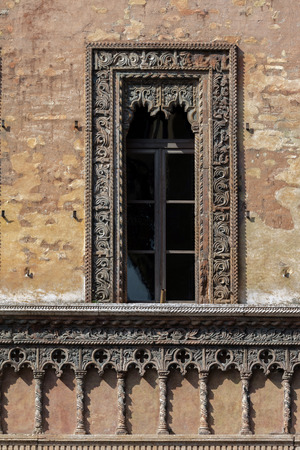 merchant: Late Gothic and Venetian style terracotta window decorations of the house of the merchant Giovan Boniforte from Concorezzo, built in 1455 in Mantua, Italy Stock Photo