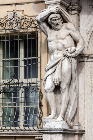 telamon: Statue of Hercules at the entrance to the 18th century Palazzo Vescovile (Bishops Palace) in the historical center of Mantua, Italy Stock Photo