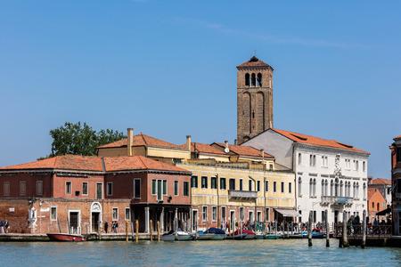 Murano: MURANO, ITALY - APRIL 30 2016: Murano island and the medieval brick campanile of the Church of Santa Maria e San Donato. Editorial