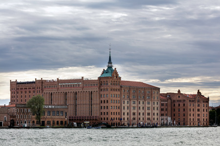 refurbished: VENICE, ITALY - MAY 2 2016: Hilton Molino Stucky is a former flour mill refurbished to become a unique hotel.