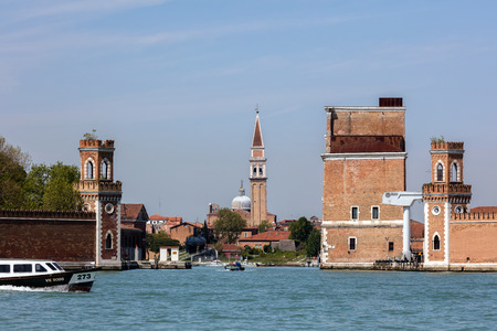 vigna: VENICE, ITALY - APRIL 30 2016: Entrance to the Venetian Arsenal with the bell tower of the San Francesco della Vigna in the background.