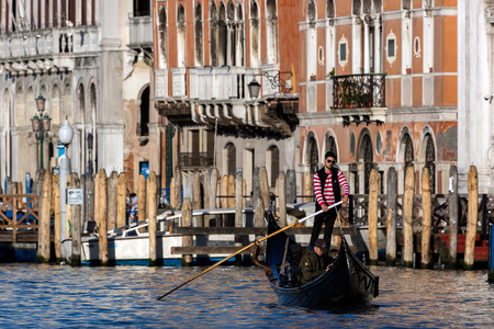 grand canal: VENICE, ITALY - APRIL 29 2016: Venice gondolier on the Grand Canal Editorial