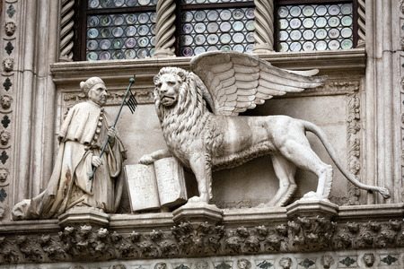 doge: Statue of the Doge Francesco Foscari (1423-1457) kneeling before the Lion of St. Mark on the Doge Palace facade in Venice, Italy Editorial