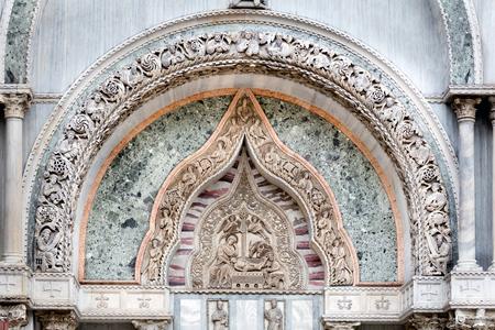 san marco: Medieval Venetian Gothic ornaments on the San Marco Basilica facade in Venice, Italy