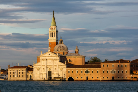 80 s: VENICE, ITALY - MAY 1 2016: Church of San Giorgio Maggiore on the island of the same name, built between 1559–80, are among Andrea Palladio's greatest architectural achievements.