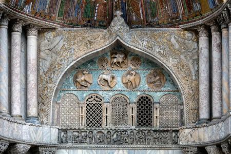 marco: Details of the medieval Venices San Marco Basilica facade above the San Alipio door.