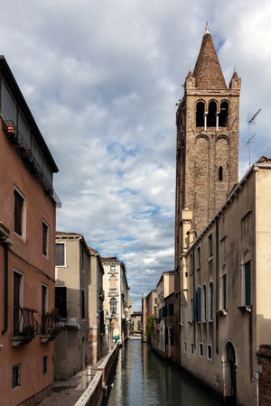 11th century: VENICE, ITALY - MAY 2 2016: 11th century campanile of the San Barnaba church with a pine-cone shaped spire from the 1300s, located in the district of Dorsoduro. Editorial