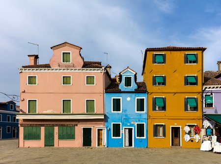 case colorate: BURANO, ITALY - APRIL 30 2016: The Venetian island of Burano is known for its brightly colored homes. The colors of the houses follow a specific system originating in the middle ages.