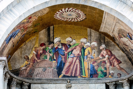 st mark: 13th-century mosaic on the facade of the St Marks Basilica depicting Alexandrias Muslim officials turning away at the sight of pork, used by Venetian merchants to hide the body of Saint Mark Editorial