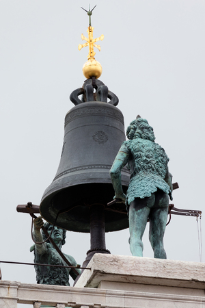 clock of the moors: Two bronze statues of Moors on top of the 15th century Torre dellOrologio in Venice, Italy strike the bell on the hour. Editorial
