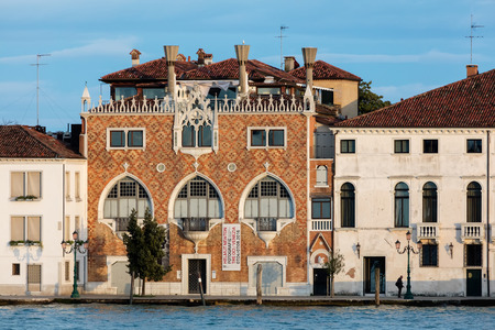 VENICE, ITALY - MAY 2 2016: The Casa dei Tre Oci or Casa di Maria, designed in 1912-1913 by the Bolognese painter Mario de Maria is a modern, neo-gothic palace located in the island of Giudecca.