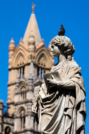 patron: Statue of the Saint Olivia of Palermo, a Christian virgin martyr who was venerated as a local patron saint of Palermo, Sicily in the Middle Ages. Standing in front of the Palermos Cathedral. Stock Photo