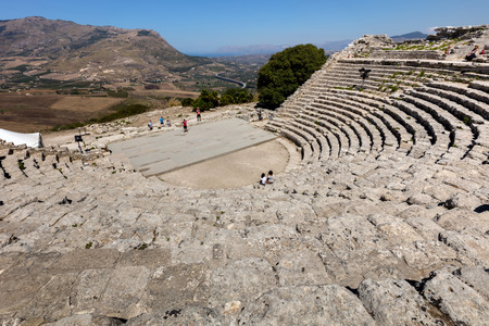 barbaro: SEGESTA, ITALY - AUGUST 10 2016: The 2nd century BCE theater of Segesta, Sicily nestling in the side of Mount Barbaro commands a spectacular view of the Gulf of Castellamare.