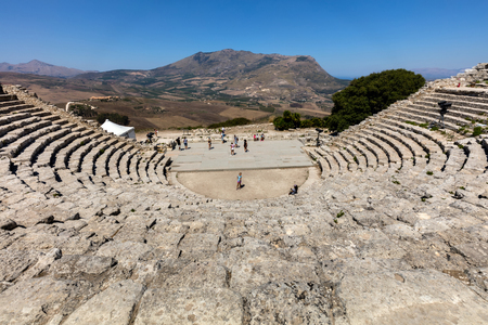 segesta: SEGESTA, ITALY - AUGUST 10 2016: The 2nd century BCE theater of Segesta, Sicily nestling in the side of Mount Barbaro commands a spectacular view of the Gulf of Castellamare.