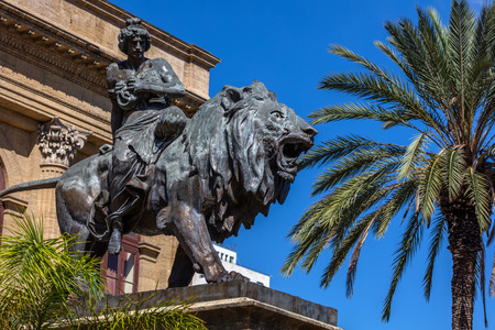 19th century bronze statue representing the Lyric seated on a lion by Sir Mario Rutelli, located next to the Massimo Theaters entrance staircase in Palermo, Sicily.