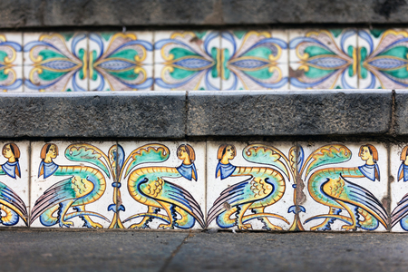 wares: Details of the hand-decorated ceramic tiles of the 18th century Staircase of Santa Maria del Monte, main landmark of Caltagirone, Sicily. The town is famous for its maiolica and terra-cotta wares. Stock Photo