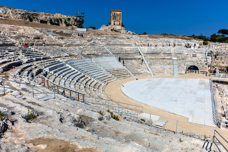 SYRACUSE, ITALY - AUGUST 14 2016:  Greek theater in Syracuse, Sicily, Italy, one of the largest in the world, dates back to 5th century BC.