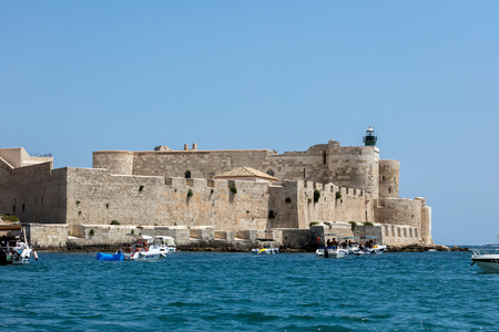 ortigia: SYRACUSE, ITALY - AUGUST 14 2016: Maniace castle in Syracuse, Sicily, Italy, named after the Byzantine general George Maniakes who took the city in 1038, constructed between 1232 and 1240. Editorial