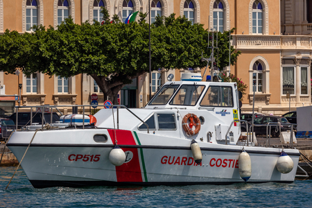 SYRACUSE, ITALY - AUGUST 14 2016: Coast Guard boat in the Syracuse harbor in Sicily, Italy