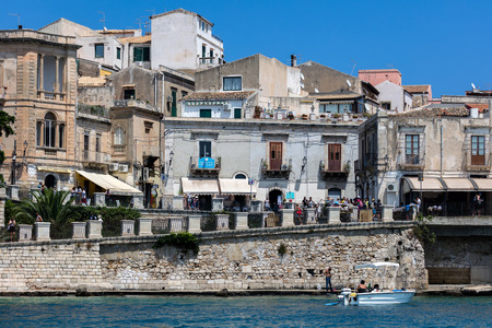 ortigia: SYRACUSE, ITALY - AUGUST 16 2016: Waterfront of the Ortigia island, the historical center of the city of Syracuse, Sicily, Italy.