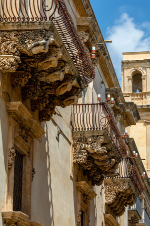 principe: 18th-century Baroque palace Nicolaci del Principe di Villadorata in Noto, Sicily, Italy features wrought-iron balconies supported by a swirling pantomime of grotesque figures.
