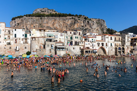 CEFALU, ITALY - AUGUST 20 2016: The city of Cefalu, the ancient Kephalodion - a Greek term that means Head and refers to the natural shape of the Rock which dominates the city.
