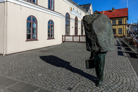 bureaucrat: Monument to the Unknown Bureaucrat, a 1994 sculpture by Magnus Tomasson depicts a man in a suit with his head and shoulders subsumed in a slab of unsculpted stone Editorial