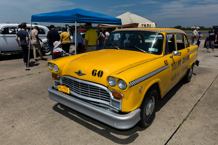 BROOKLYN, NEW YORK - JUNE 11 2017: A Checker Yellow Taxicab on display at the Antique Automobile Association of Brooklyn Annual Show at the Floyd Bennett Field in Brooklyn, New York, USA.