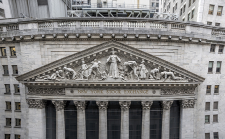 Closeup of the limestone pediment on the facade of the world famous New York Stock Exchange building on Wall Street, sculpted by John Quincy Adams Ward in 1904 Stock Photo