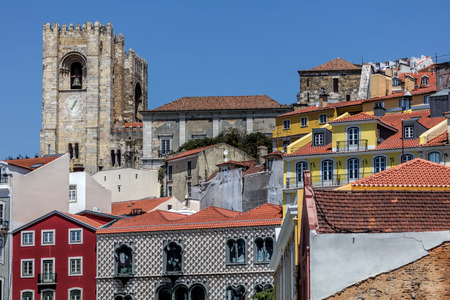 Crenelated tower of the Lisbon Cathedral is a relic from the Reconquista period, when the cathedral could be used as a base to attack the enemy during a siege. Stok Fotoğraf