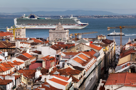 Cruise ship passing Lisbon, Portugal. View from the Santa Justa Lift. Stock Photo
