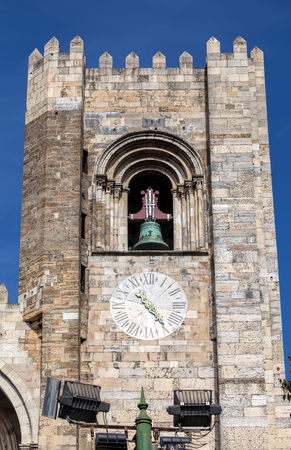 Crenelated tower of the Lisbon Cathedral is a relic from the Reconquista period, when the cathedral could be used as a base to attack the enemy during a siege. Stock Photo