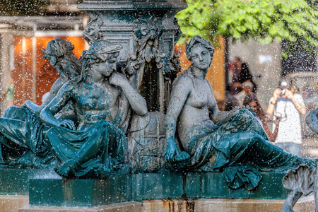 Bronze divinity statues in the Rossio Squares fountain, built in 1889 in Lisbon, Portugal