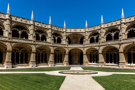 Two-storey cloisters of the Jeronimos Monastery. The monastery is one of the most prominent examples of the Portuguese Late Gothic Manueline style of architecture in Lisbon.