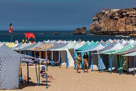 Praia da Nazare beach, covered with the summertime beach tents. Editorial