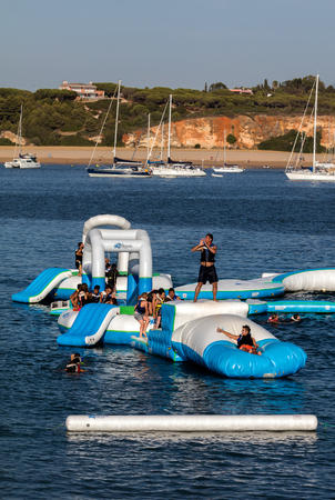 Navibordo Water Sports installation on the Portimaos Praia da Rocha beach Редакционное